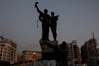 A noose placed by protesters angry at the government hangs from the Martyr's Square monument in Beirut, Lebanon.