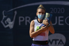 Simona Halep celebrates with the Prague Open trophy after victory in her first tournament since the coronavirus shutdown.