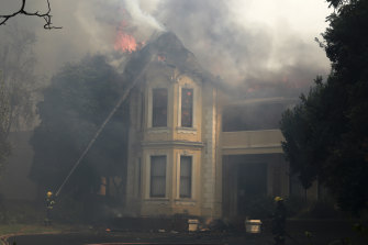 Firefighters work to douse a burning building at the University of Cape Town on Sunday.
