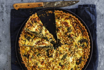 Spinach tart with pine nuts, cheese and herbs.