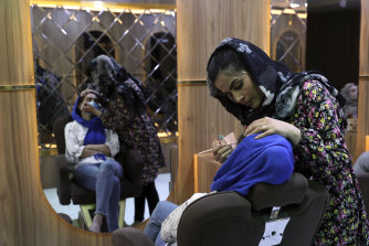 Sultana Karimi applies make-up at a beauty salon in Kabul. Some Afghan women fear the return of the Taliban and their hard-line stance on women's rights.