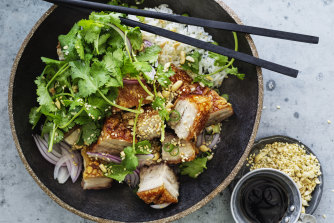 Crispy pork belly with coriander, peanut and red onion salad.