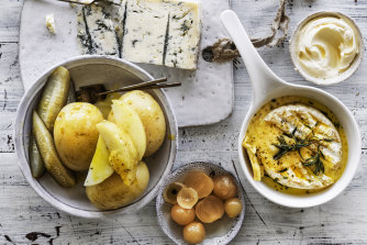 Boiled potatoes with baked camembert.