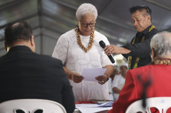 Samoa's Prime Minister-elect Fiame Naomi Mata'afa takes her oath at an unofficial ceremony outside parliament in Apia on Monday.