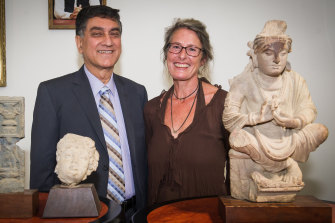 Romy Dingle hands back the Buddha to Pakistan's High Commissioner, Babar Amin.