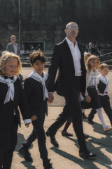 Peter Wilson arrives with his crew of sailor boys and girls at last Saturday's wedding on Cockatoo Island.