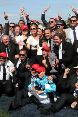 For the people: Jockey John Allen celebrates Extra Brut's Victoria Derby victory with connections on Saturday.