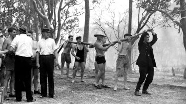 Locals and swimmers assist exhausted firemen in Sylvania in Sydney on January 14, 1939. At the time it was the hottest day on record in NSW.