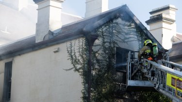Fire crews battle a house fire in Glebe.