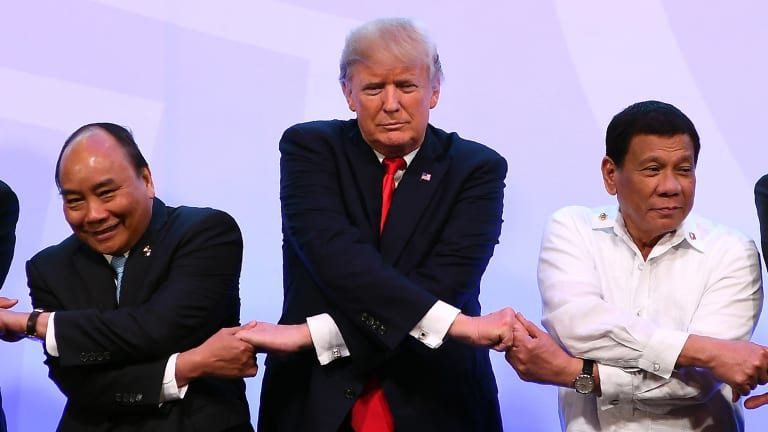 Nguyen Xuan Phuc, with Donald Trump and Philippine President Rodrigo Duterte at the ASEAN-US summit last year.
