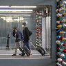 Travellers walk through O'Hare International Airport in Chicago, where authorities are bracing for a spike in COVID cases due to the Thanksgiving weekend travel.