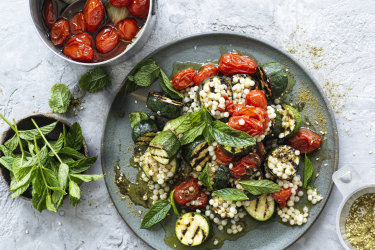 Hetty McKinnon's grilled zucchini, zaatar and pearl cous cous salad with cherry tomato confit.