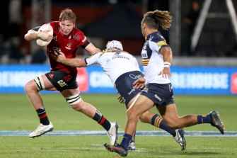 CHRISTCHURCH, NEW ZEALAND - MAY 15: Cullen Grace of the Crusaders tries to get past Rory Scott and Issak Fines-Leleiwasa of the Brumbies  during the round one Super Rugby Trans-Tasman match between the Crusaders and the ACT Brumbies at Orangetheory Stadium on May 15, 2021 in Christchurch, New Zealand. (Photo by Peter Meecham/Getty Images)