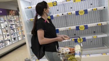 Empty supermarket shelves in a supermarket in London, United Kingdom.