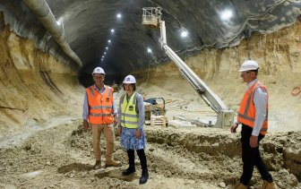 Transport Minister Andrew Constance, left, Premier Gladys Berejiklian and Rodd Staples inspect a Metro station site.