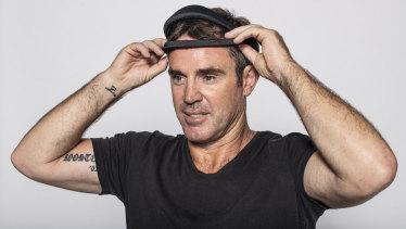 NSW coach Brad Fittler tries on the Dreem sleep assessment headband.