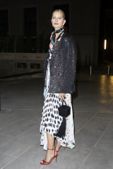 Fringe benefits ... Karolina Kurkova in Milan with one of the season's hottest trends on her arm.