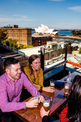 Patrons enjoying Sydney's warm weather on the rooftop of the Glenmore Hotel.