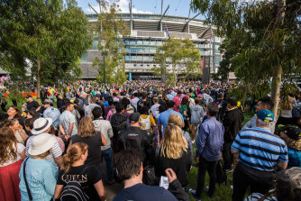 Crowds of people pour into the MCG for the Women's T20 World Cup final in March.