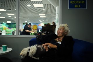 Ayesha Kazan and her dog Yuhu in the observation area after Ms Kazan received her COVID-19 vaccine.
