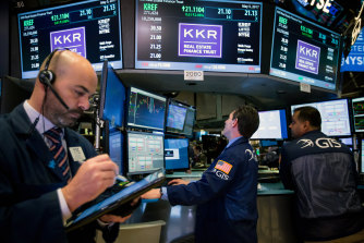 Traders work on the floor of the New York Stock Exchange.  KKR / GTS