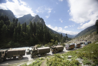 An Indian army convoy moves on the Srinagar-Ladakh highway at Gagangeer, north-east of Srinagar, Indian-controlled Kashmir.
