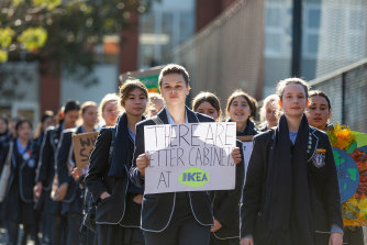 Camberwell Girls Grammar School year 11 studentCharli Lincke (holding sign) and year 12 student Holly Williams lead classmates into the city for the rally on Friday.