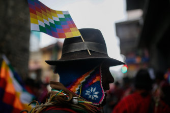 Pro-Morales protesters carried Wiphala flags, a symbol used by some of South America's indigenous peoples.