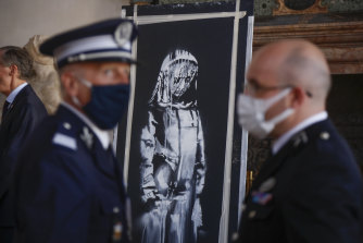 The recovered stolen artwork by British artist Banksy during the handover ceremony at the French Embassy in Rome.