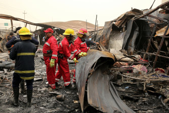 Workers search for bodies after a catastrophic blaze destroyed a COVID-19 ward at a hospital in Nassiriya, Iraq.