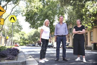 Millers Point residents Margaret Wright, left, Bernard Kelly, and Yasmina Bonnet on Kent Street, along which the cycleway will be built.