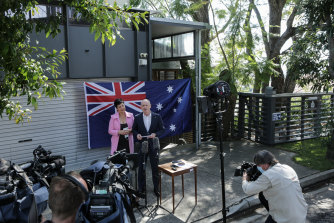 Former Queensland premier Campbell Newman announces his return to politics from the driveway of his Brisbane home with wife Lisa.
