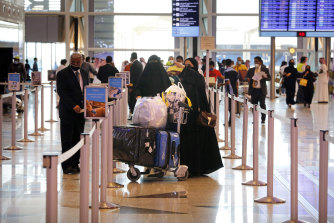 Saudi passengers enter King Abdulaziz International Airport in Jiddah, Saudi Arabia, where vaccinated citizens are allowed to leave the kingdom for the first time in more than a year.
