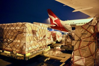 COVID-19 supplies for India being loaded into a Qantas plane on Wednesday.