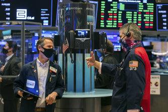 Wall Street slid across the board, with bank stocks falling sharply.