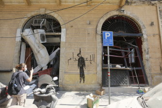 Graffiti reading 'The Hanging' is seen on a damaged building in downtown Beirut.