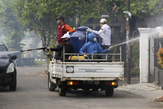 A street in Tangerang, near Jakarta in Indonesia, is sprayed with disinfectant to try to stop the spread of coronavirus.