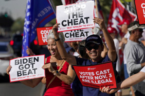 Dozens of pro-Trump protesters gathered to protest in Phoenix after Democratic challenger Joe Biden was reported to have flipped the Republican stronghold of Arizona.