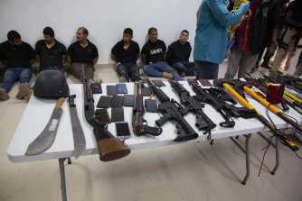 Suspects in the assassination of Haiti's President Jovenel Moise are shown to the media, along with the weapons and equipment they allegedly used in the attack.