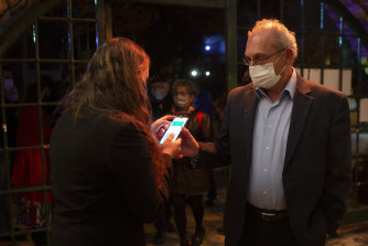 A man presents his Green Pass as  proof of coronavirus vaccination,  at the Khan Theatre in Jerusalem.