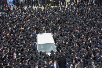 Thousands of ultra-Orthodox Jews participate in the funeral for prominent rabbi Meshulam Soloveitchik, in Jerusalem despite the country's ban on large public gatherings due to COVID-19.