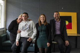 Lesley Deegan with her son, Joshua, social worker Alyssa Cassidy and Coreen School principal Tim Gardner.