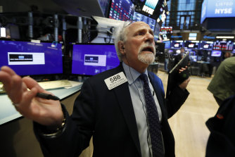 Trader Peter Tuchman on the floor of the New York Stock Exchange on Monday.