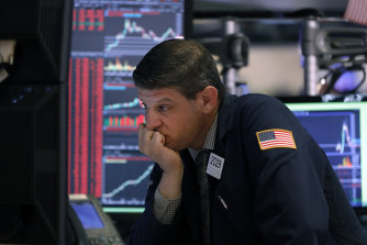 A 7 per cent plunge on Wall Street on opening forced a 15-minute trading halt.