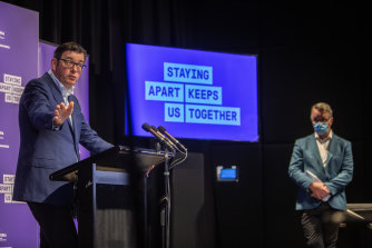 Mr Andrews alongside new Health Minister Martin Foley on Sunday.