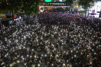 Pro-democracy protesters rally at the Ratchaprasong Intersection in Bangkok on Sunday.