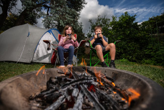 Archie Smith, 11, and his sister Dana, 8, have been whittling and drinking tea in their backyard.
