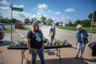 """I've never been a Democrat but the older I get the more I'm going that way"": Cyndee Rivera selling cactus teapots in Macomb County, Michigan."