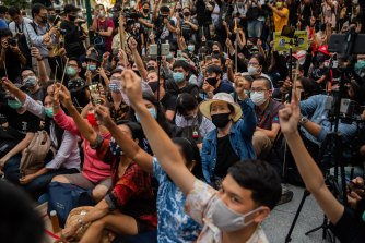 Anti-government protesters wave chopsticks as makeshift wands while they take part in a Harry Potter themed rally in Bangkok on Monday.