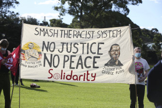A banner at the Black Lives Matter rally in The Domain.